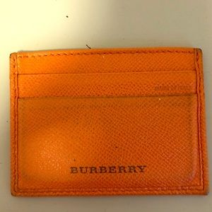 Orange Burberry card holder.